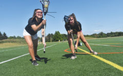 Double Time: Juniors Anna and Gretchen Moore share their experience playing on CHS lacrosse team as identical twins