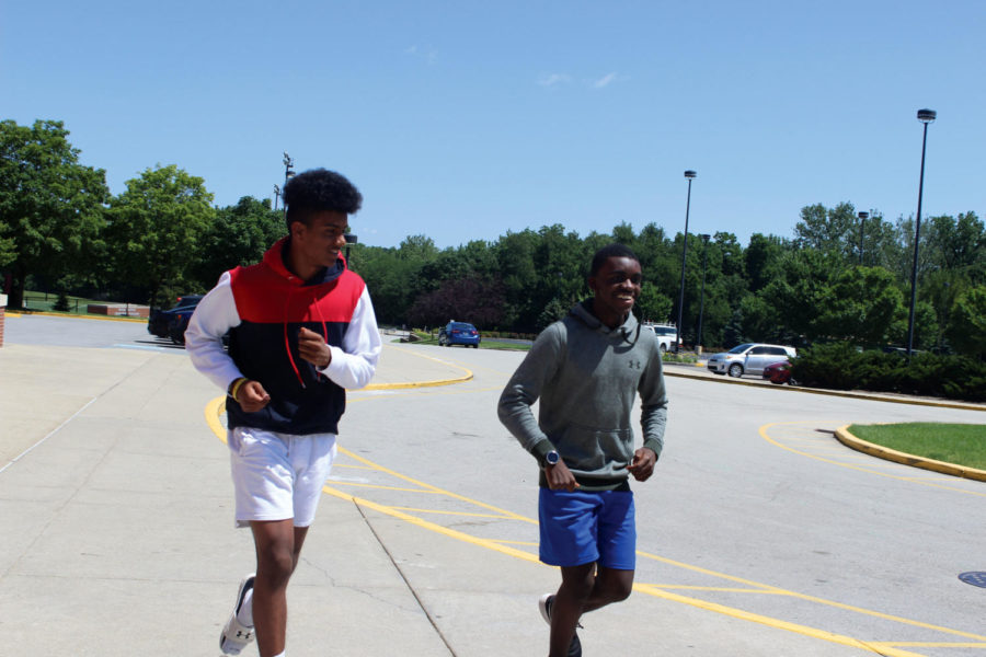 "Amit Manchella, cross-country runner and sophomore, and Daniel ""Dan"" Musapatika, cross-country runner and junior, run together at summer  practice. Manchella said summer helps prepare the team for the season when the school year starts."