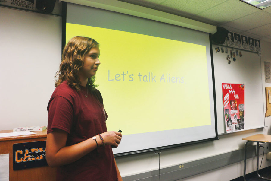Claire Van Meter, Conspiracy Club president and senior, explains aliens at a Conspiracy Club meeting. Club members met on Sept. 5 to discuss Area 51.