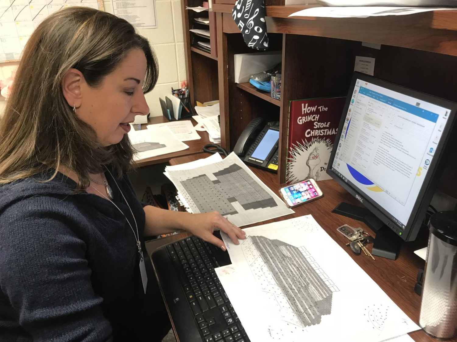 Director of Choirs Katherine Kouns prepares stage plans for the fall concert. The concert is scheduled for October 8.