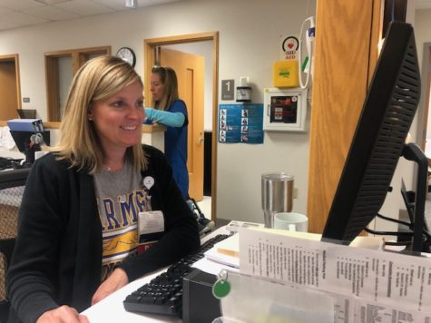 RN Amy Fletchall reviews student immunizations on her desktop. Fletchall said the new policy is mandatory for the center to follow.