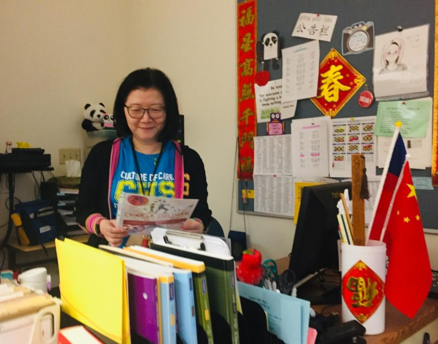 "National Chinese Honors Society sponsor Tungfen Lee looks at the NCHS flyer for this year's events. According to Lee, NCHS is trying to appeal to middle schoolers and are trying to have a more prominent role in CHS by ""appearing (and being) heard more"" in CHS culture."