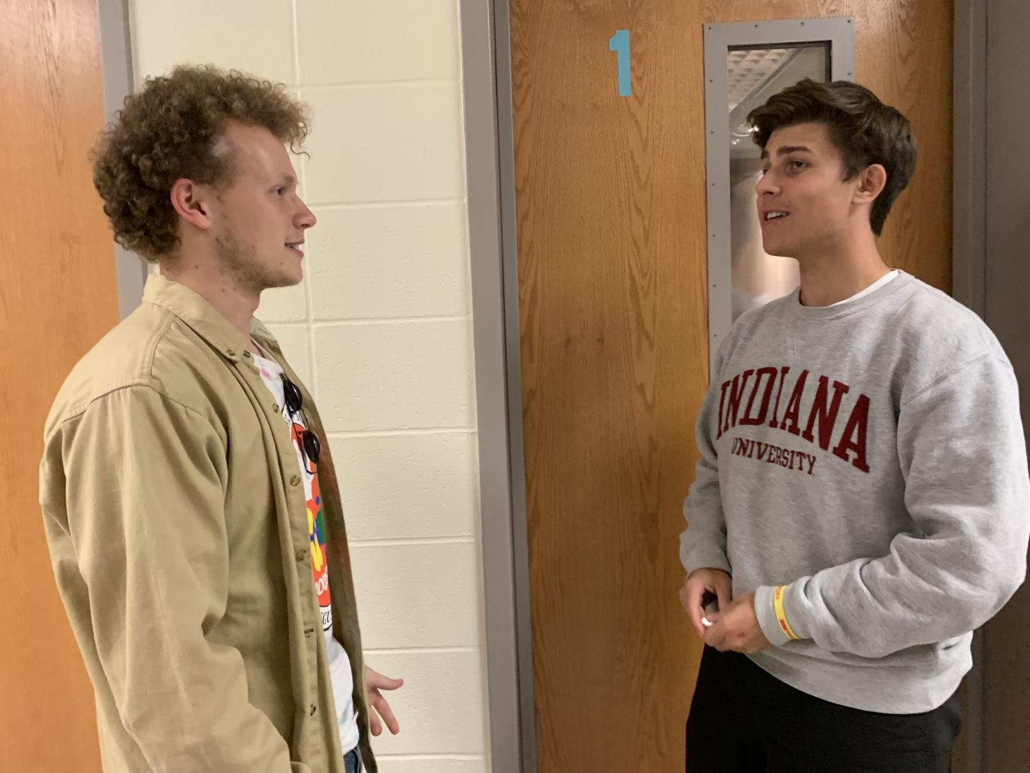 Connor Inskeep, GKOM Council member and senior, talks to junior Robert Pugh. Inskeep said he is excited to watch GKOMs develop their relationships with freshmen.