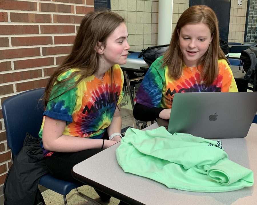 DANCER SHIRTS: Junior Reagan Fahey (LEFT) and Sophomore Ella Konow (RIGHT), cabinet members, prepare to distribute Dance Marathon shirts on Feb. 27. The distribution took place during SRT.