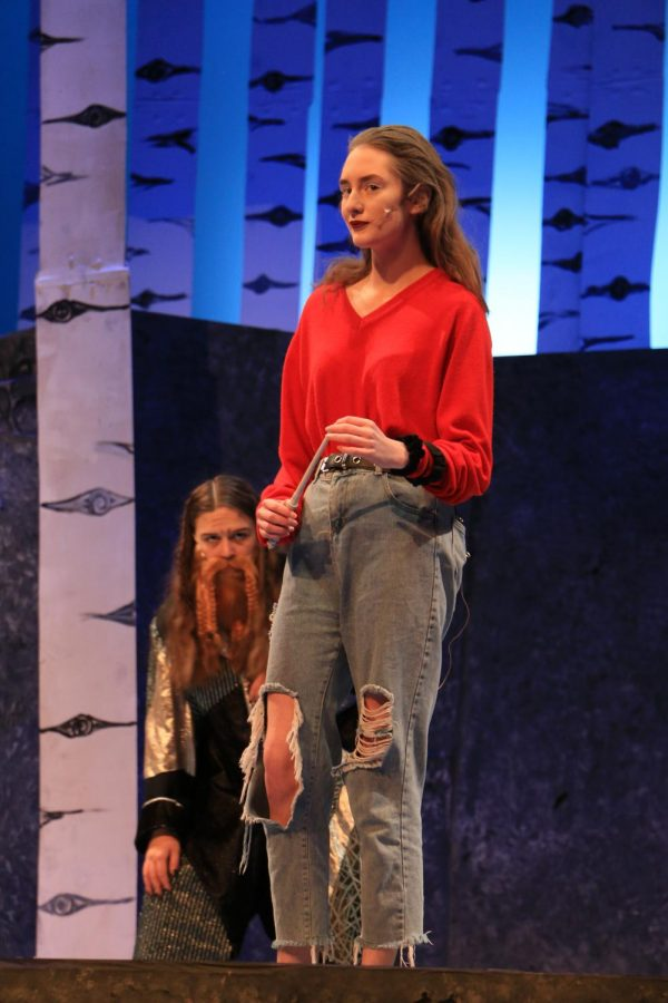 "Luring Dwarf: Senior Madison Diehl (front) dialogues her plots of manipulation against the Pevensie children as junior Ivy Nugent awaits behind her during rehearsal for ""The Lion, The Witch, and the Wardrobe"" on Feb. 5. This will be Diehl's last year in a CHS winter production as she is a senior."