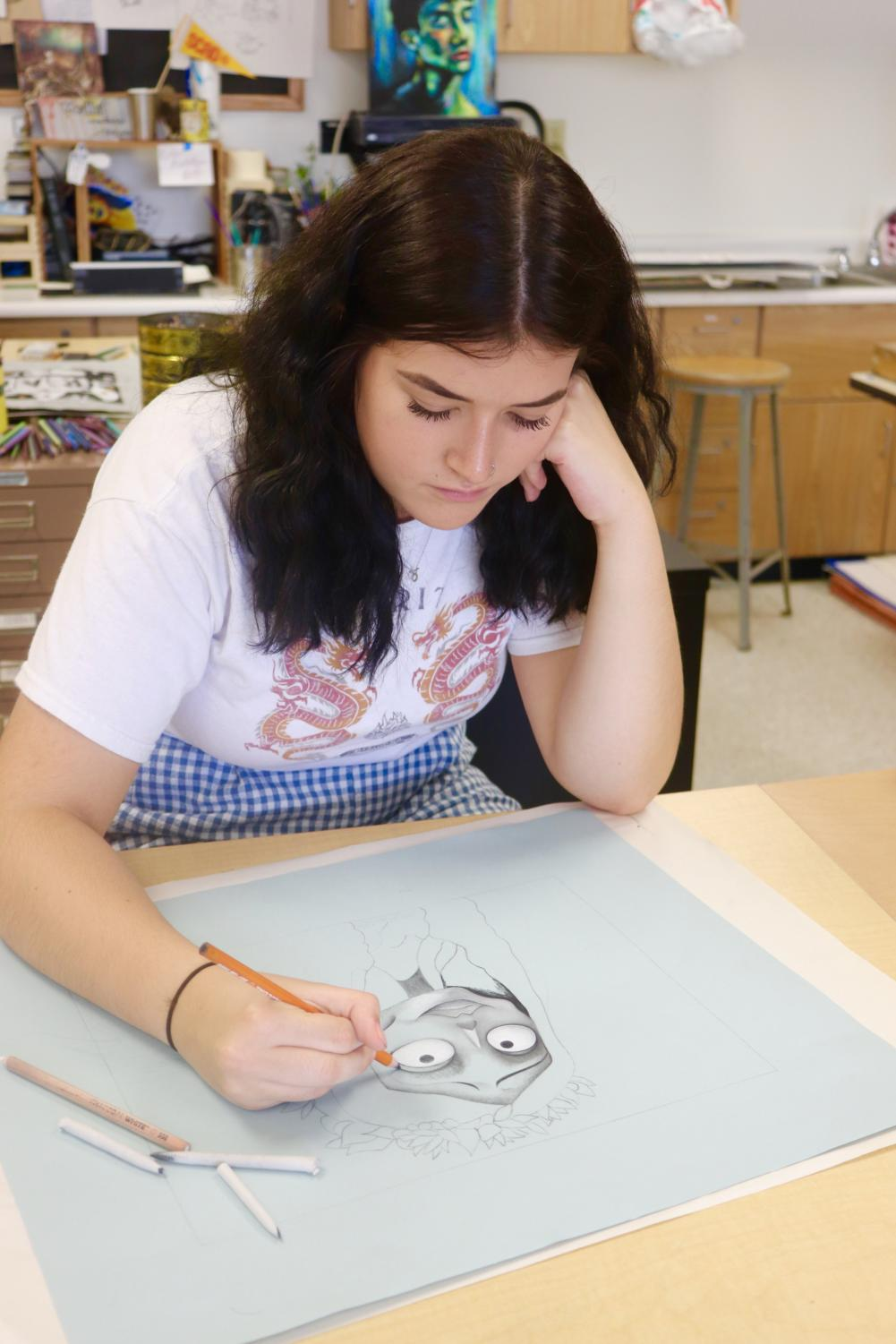 LIFE+IN+BLACK+AND+WHITE%3A+Kenley+Williams%2C+Drawing+3-4+student+and+junior%2C+lays+the+foundation+for+her+most+recent+piece+during+class+on+Tuesday%2C+Sept.+3.+The+drawing+students+had+recently+been+assigned+black+and+white+drawings+using+colored+pencils%2C+requiring+a+variety+of+blending+and+shading+techniques.+Williams%2C+as+well+as+many+other+students%2C+utilized+a+gothic+subject+for+her+piece+in+order+to+work+with+a+variety+of+shadows.