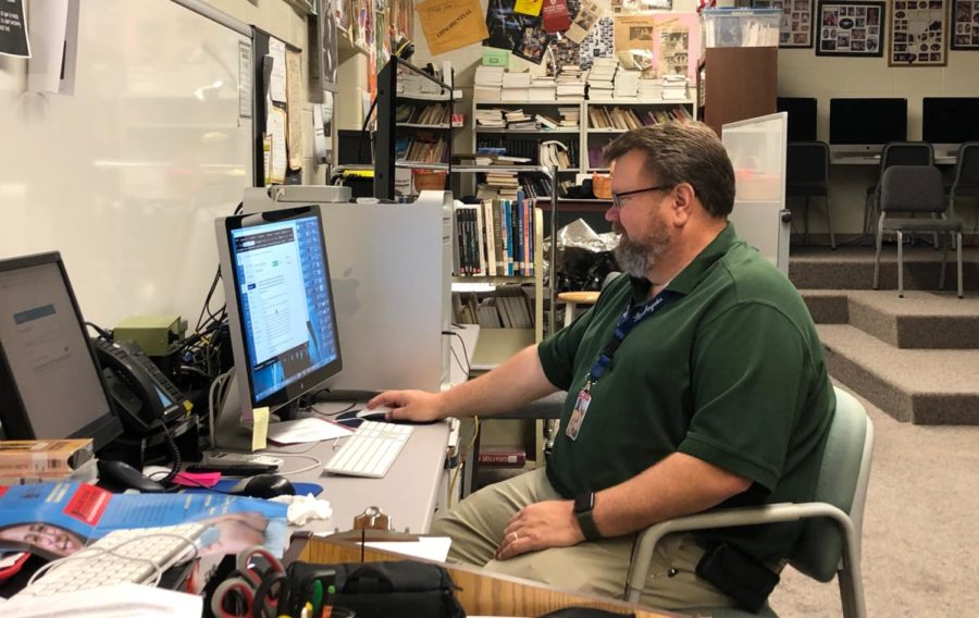 Comedy Sportz sponsor and IB Film teacher James Peterson starts his morning preparing for the day on Thursday, Aug. 29. Peterson will hold auditions for Comedy Sportz on Sept. 9  in P123.