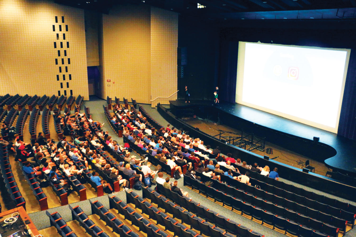 """The men's tennis and football teams watch the """"Step Up to Sexual Assault"""" presentation. The presentation was shown to the athletics and performing arts departments and student government this year."""