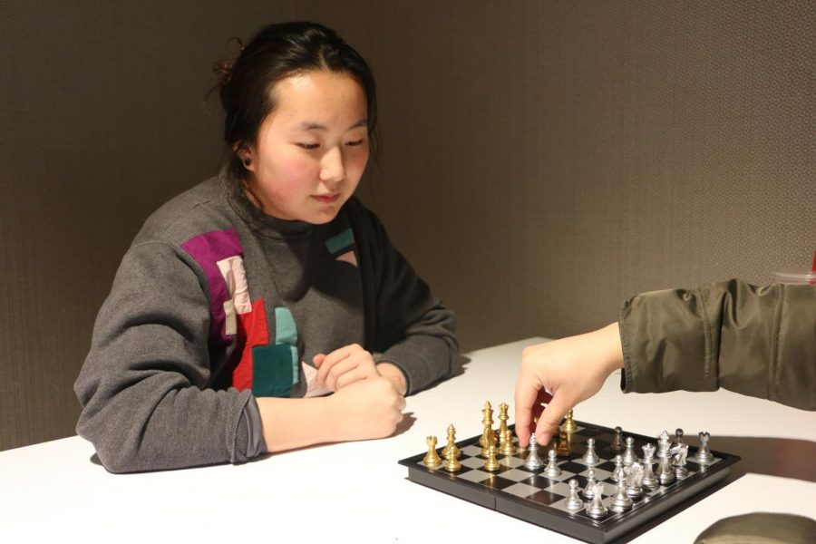 CHESS CHAMPIONS: Seniors Ava Slowey and Julianne Seldon play chess during their B4 on Jan. 24. According to Slowey, she usually leaves during her release, but decided to stay to play chess.
