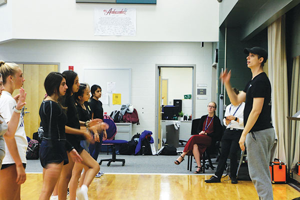 ONE STEP AT A TIME: Professional choreographer Jeff Jordan runs through the choreography for the upcoming concert with Allegro. The concert will showcase both the concert choirs and show choirs and will take place on Oct. 2 in the  CHS Auditorium.