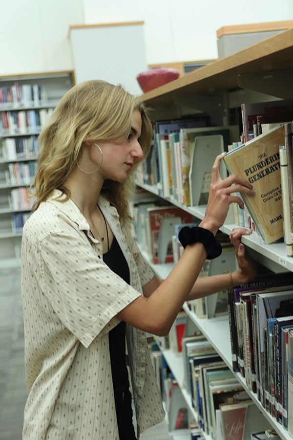 Godfrey browses through novels to read for inspiration. Godfrey said she enjoys poetry and creative writing and she hopes to take the creative writing class in the future.