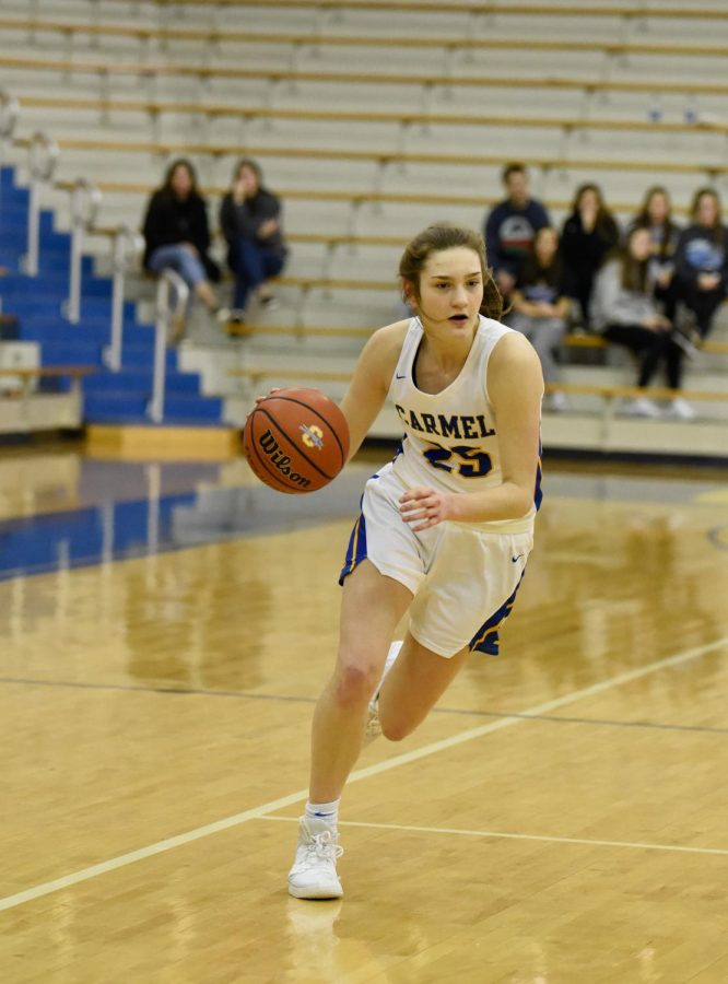 SENIOR NIGHT: Kate Clark, women's varsity basketball guard and sophomore, runs down the court in a game against the Ben Davis Giants. The Lady Hounds came out with a hard fought 57-43 victory on the greyhound senior night.
