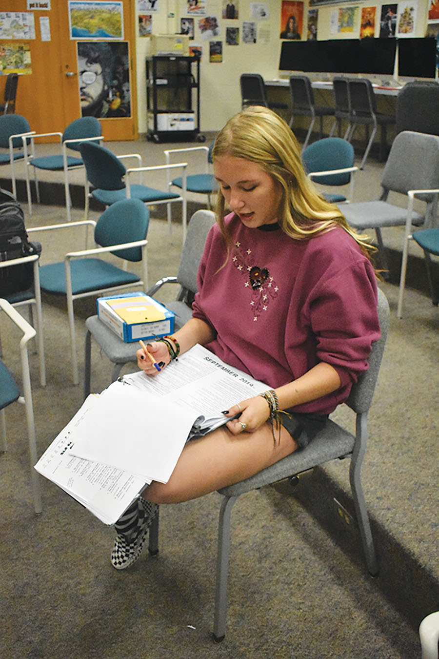 DIRECTOR'S CUT: (RIGHT) Delaney Kibler, Studio One Acts student director and senior, reads through a script during rehearsal after school. Kibler said her role as a director is to cast actors, create props and costumes and to design the set  for each one-act show.