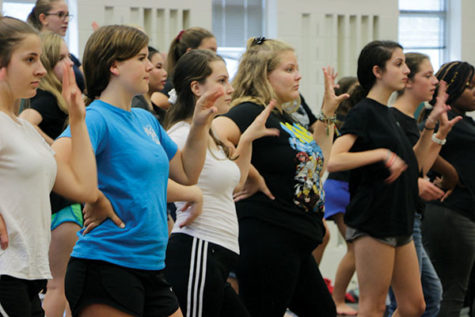 LEARNING CHOREO: Sophomore Meg Shaffer (left), junior Lindsay Vrobel (middle) and sophomore Ava Reynolds (right) practice the choreography in class. Vrobel said Allegro will learn new choreography this year to perform  at concerts.