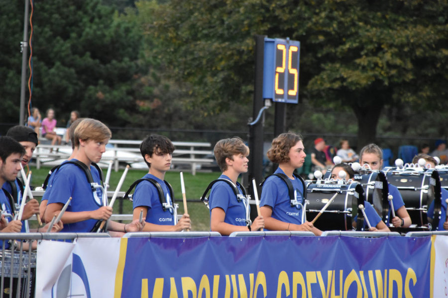 DRUM  TIME: The percussion players lead the procession of marching band performers at the halftime performance of a home football game. Jenna Kellermeyer, marching band performer and junior, said she wishes that marching band would get more recognition like sports such as football and basketball.