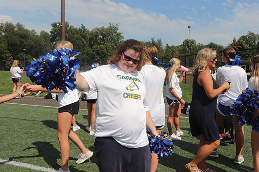 Unified Cheer athlete Maddy Paxton practices her routine with her pom poms. Katie Suder, Unified Cheer coach and senior, said she believes cheer is a fun sport that anyone can participate in.