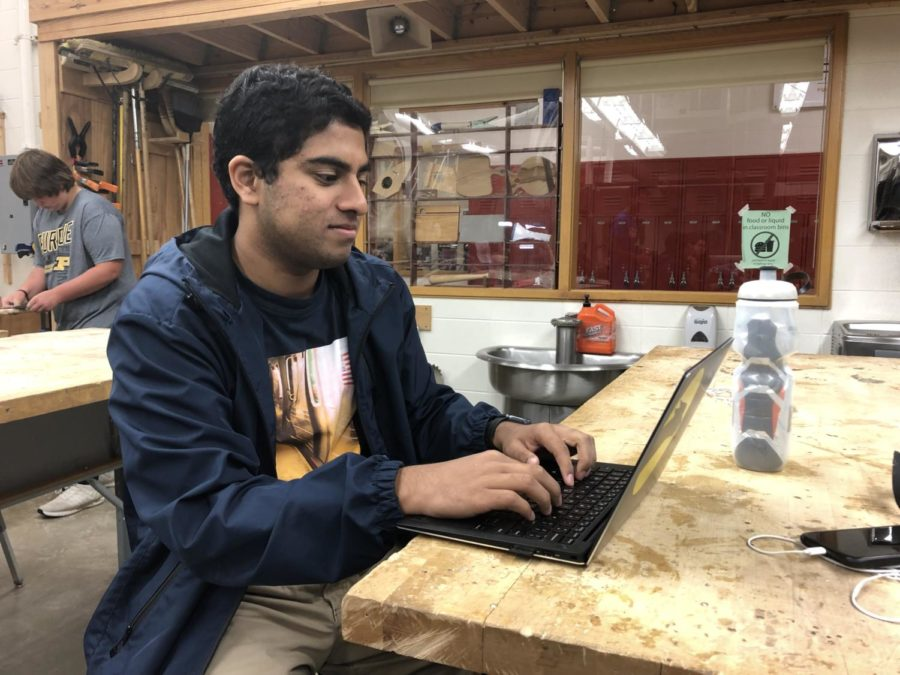 Karthik Arcot, club member and senior, does work on his laptop during SRT. Arcot said that Design for CHS will be continuing with the Street Store and Hands on Education projects this year as well as starting a new project called Heart Shakers.