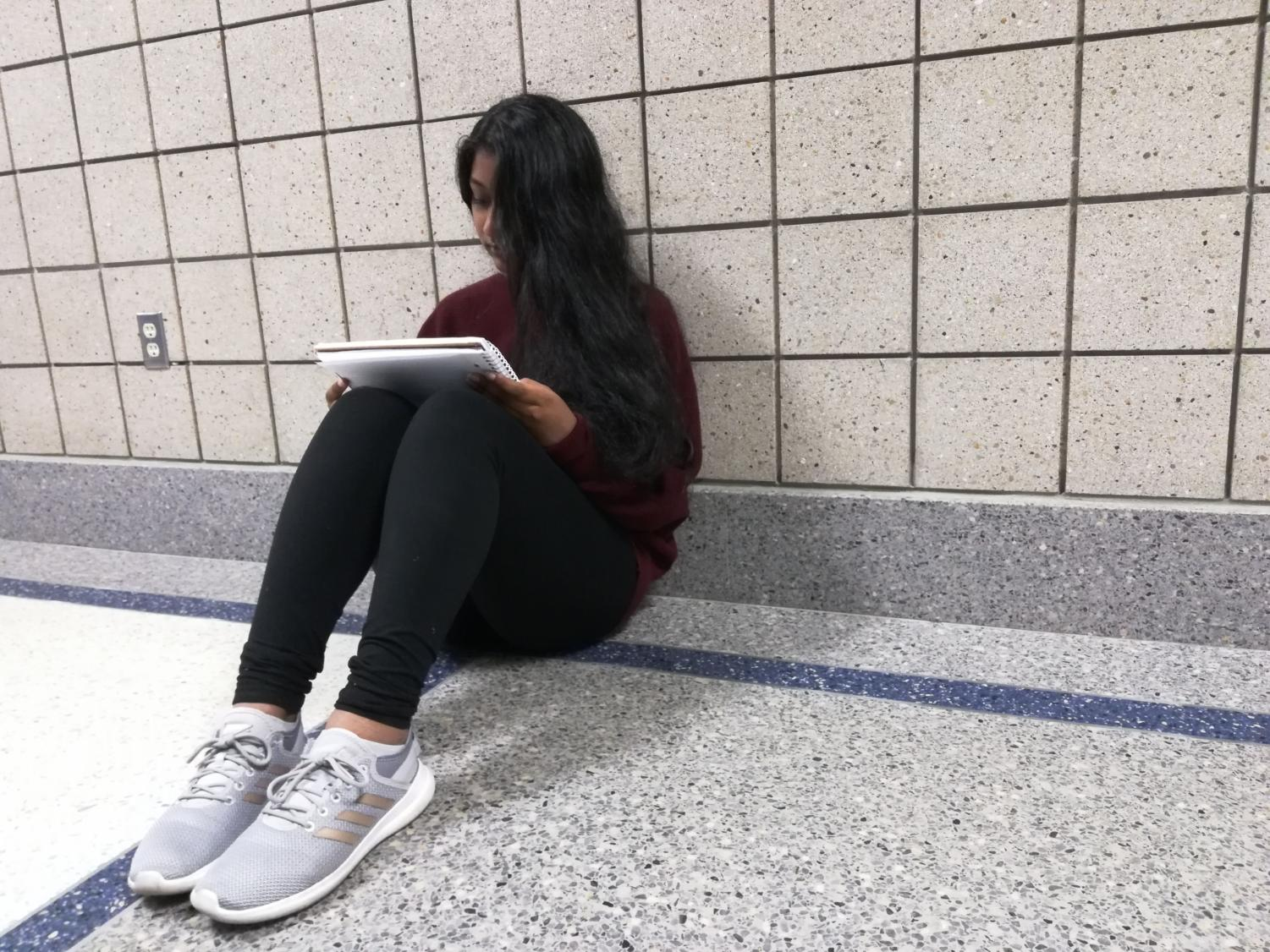 Sophomore Manasa Kesa looks over her notes for AP European History and decides whether or not to register for the exam at the end of the year. AP exam registration will begin Oct. 14 and end Oct. 27.