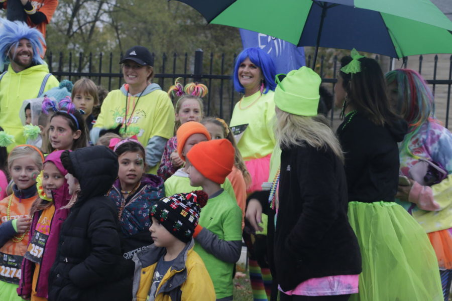 Costumed students and staff of various schools in the Carmel Clay school district gather to take a group picture in the West Parking Lot. Prairie Trace Elementary School had the highest number of elementary students participate in the race.