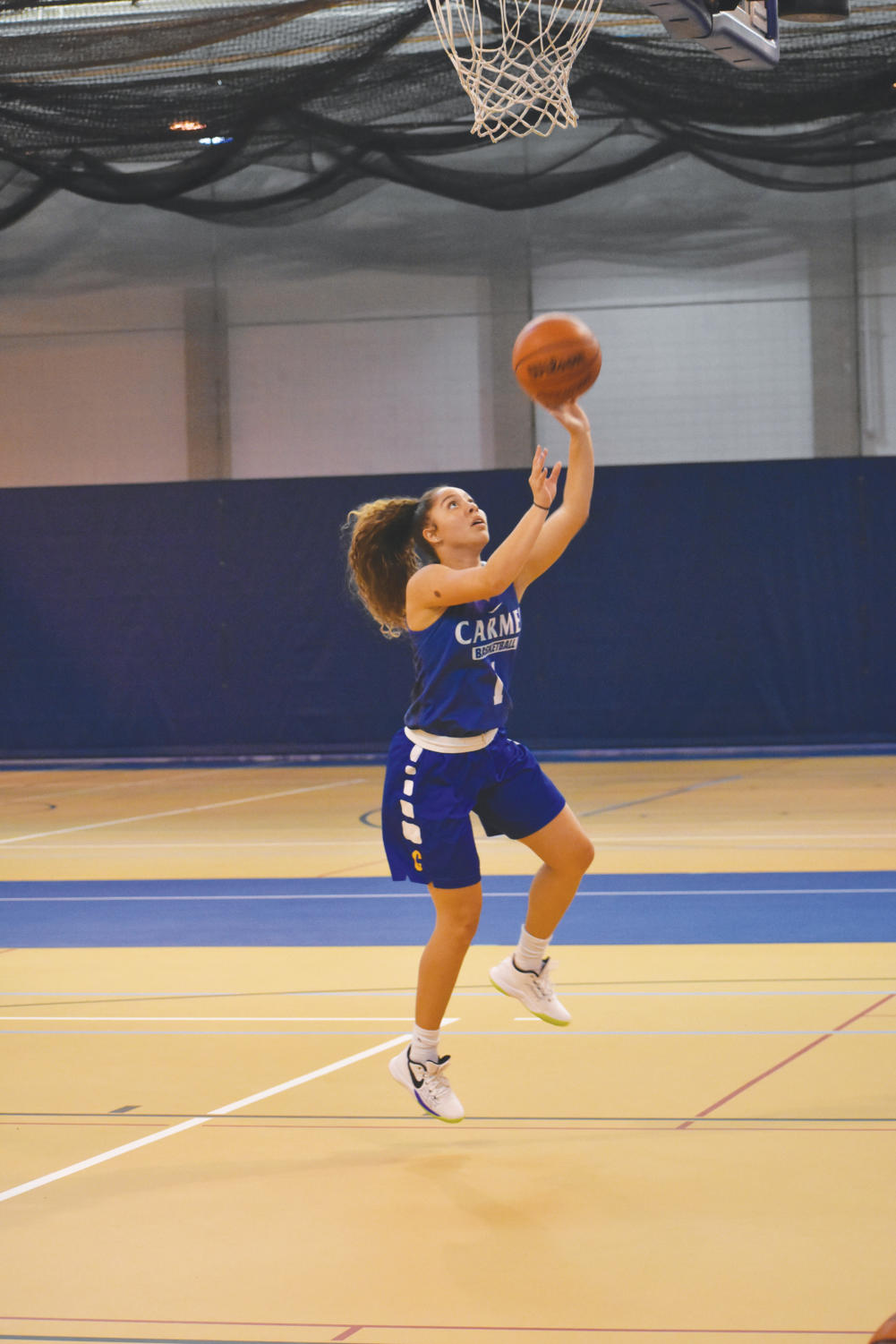 SOFT TOUCH: Senior Kiara Gill shoots a floater during practice. Gill said the team shared a close bond even before tryouts commenced, adding that those bonds will be crucial for a successful season.