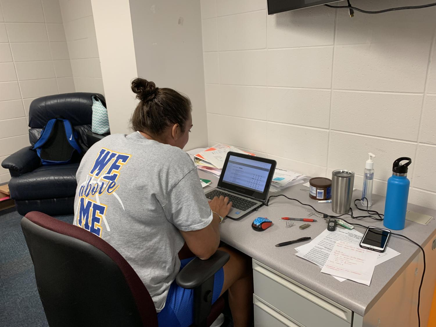 """Erin Modisett, sponsor of Big Game Club, thinks about ways to promote Big Game Club. """"We have a lot of social media accounts. If students are interested, they should try talking to myself of Mr. Cluver or search up Greyhound Nation on Twitter,"""" Modisett said."""