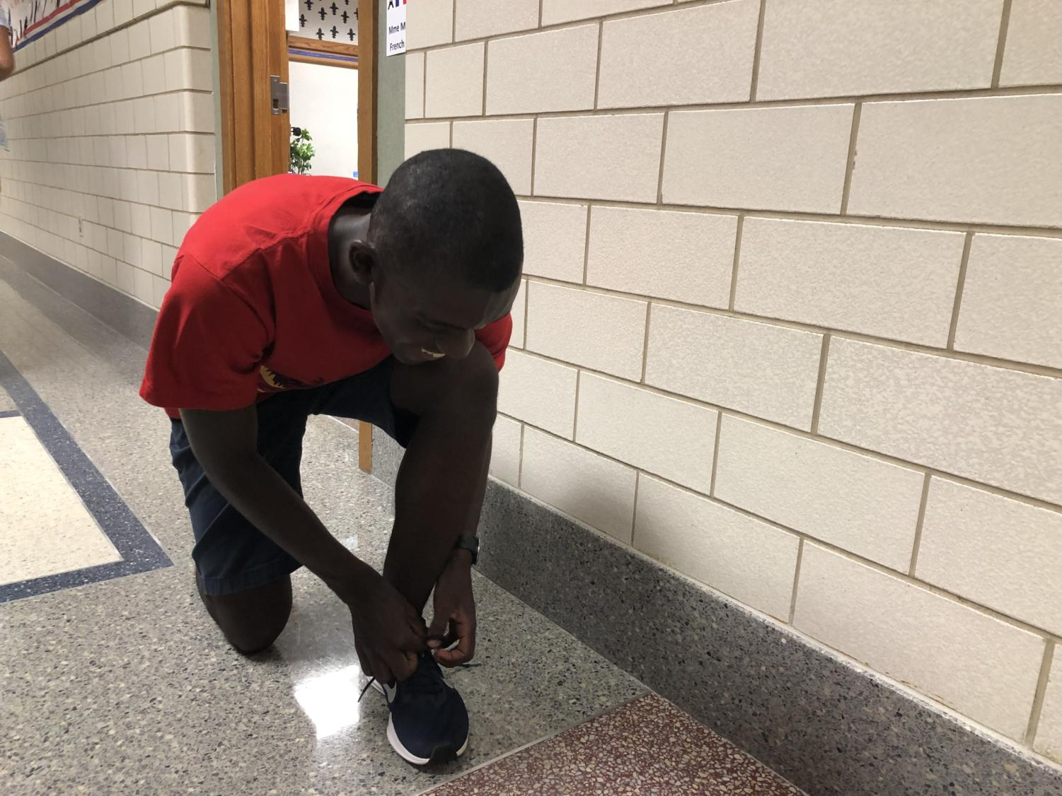 Daniel Musapatika, cross-country runner and junior, prepares for practice. Musaptika said that the team has continued to improve, and still has high expectations for State.