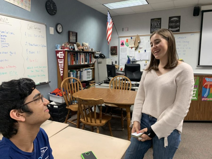 GKOM and senior Anna Berger Romeau talks with senior Abinay Devarakonda. Berger Romeau said one of her favorite aspects of being a GKOM is being able to connect and form relationships with the freshmen.