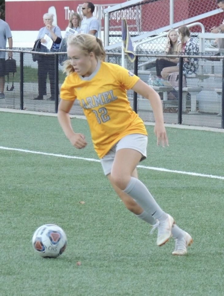 "Looking for the next pass, forward and sophomore Lauren Rainbolt dribbles up the field. ""We're ready for the State [tournament] with this group of girls. We've only gotten better this whole year,"" said Rainbolt."