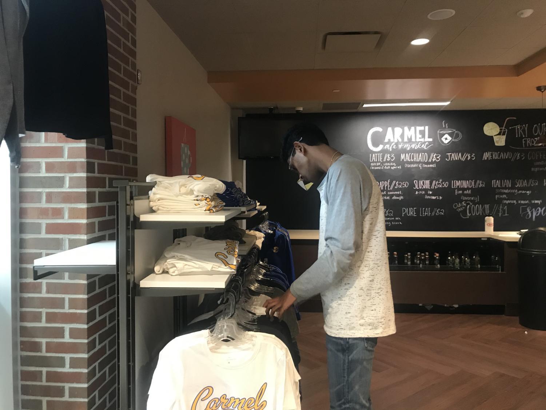 Senior Roshan Mahesh looks through merchandise in the Carmel Café during SRT. Mahesh said,