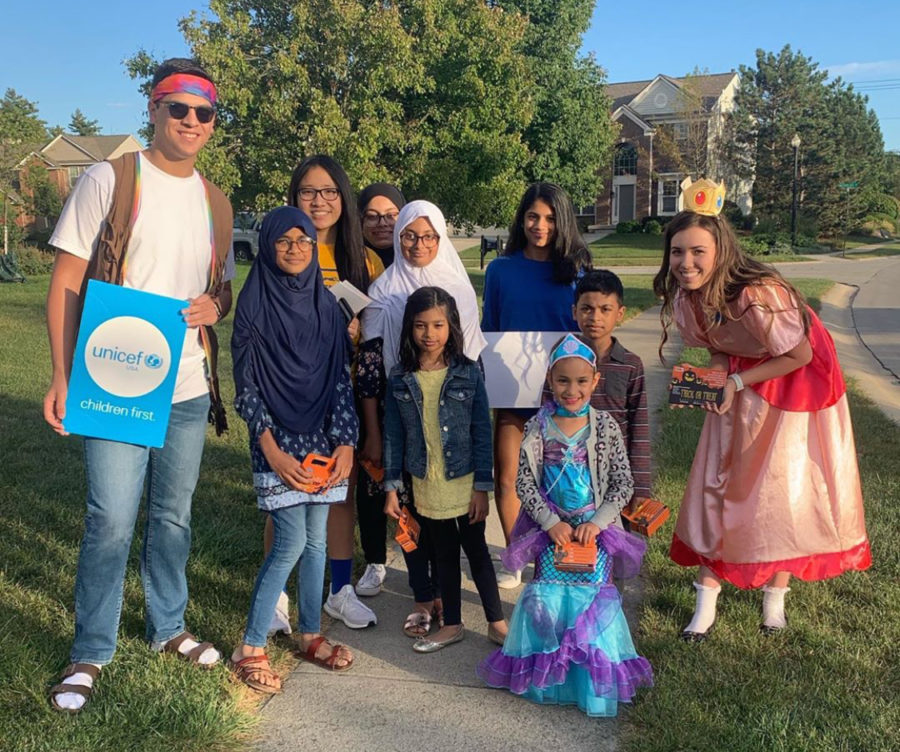Carmel+UNICEF+high+school+and+elementary+school+volunteers+pose+for+a+picture+before+their+first+Trick-or-Treat+for+UNICEF+Friday+run+on+Oct.+4.+Viha+Bynagari%2C+Carmel+UNICEF+co-president+and+senior%2C+said+the+Trick-or-Treat+for+UNICEF+runs+will+take+place+every+Friday+in+October%2C+and+anyone+is+welcome+to+volunteer+by+DM-ing+Carmel+UNICEF%E2%80%99s+Instagram.