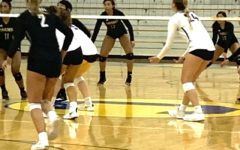 Women's varsity volleyball loses one game, wins another