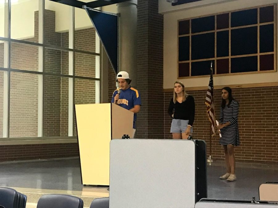 (Picture left to right) NHS president Kieran Thompson, NHS vice president Emme Walschlager, and NHS business manager Parul Gupta remind NHS members to keep up with volunteer hours. NHS members are able to curate volunteer hours by helping plan and promote the Ghost and Goblins 2k/5k or tutoring during late start and SRT.