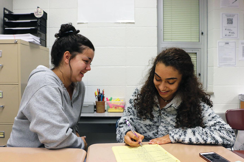 Junior Mckensie Matthews (LEFT) helps junior Natalie Hanna with Spanish. Matthews said she loves using the language to help others.