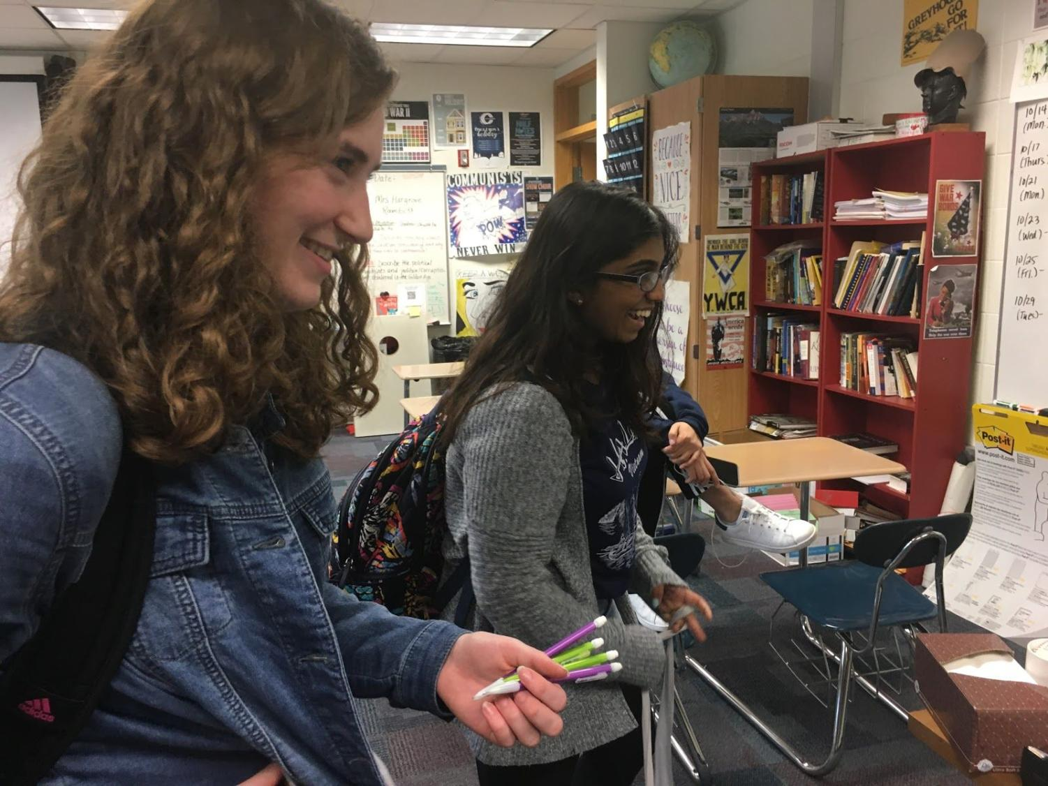 Sarah Konrad, design head and junior, takes part in a conversation after school with her friends. Konrad said that right now, the TEDx club is focused on increasing its membership.