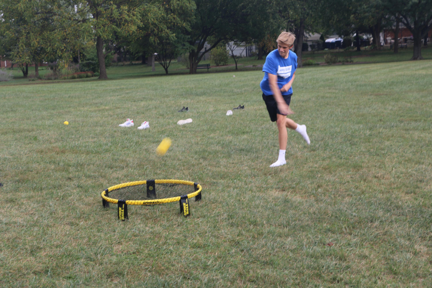 """POWER SLAM: Andrew """"Hudson"""" Alden, Spikeball Club member and junior, pounds a spikeball at the roundnet during a game. The unpredictable bounces off the net emphasize the importance of quick reflexes and anticipation."""