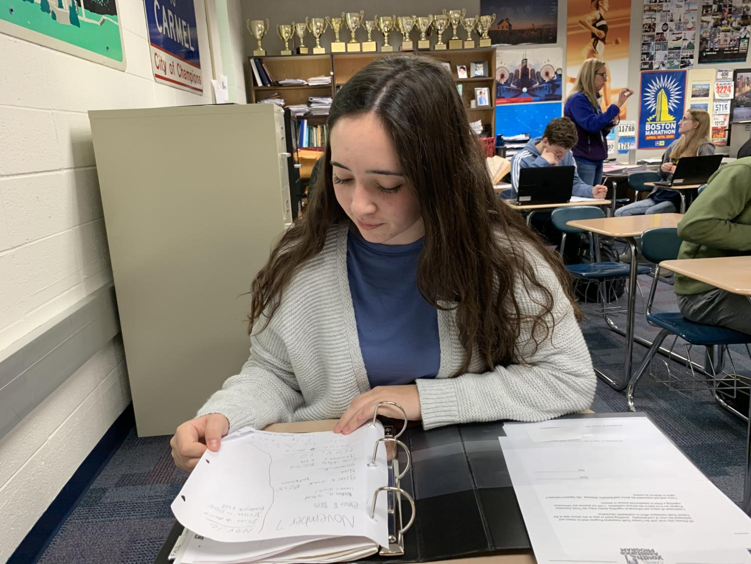 Nina Metaxas, Carmel Mayor's Youth Council (CMYC) vice president and senior, looks at her binder during SRT. Metaxas said CMYC is working hard to plan their holiday events, Toy Drive and Kid's Booth, both of which will take place during the first week of December.