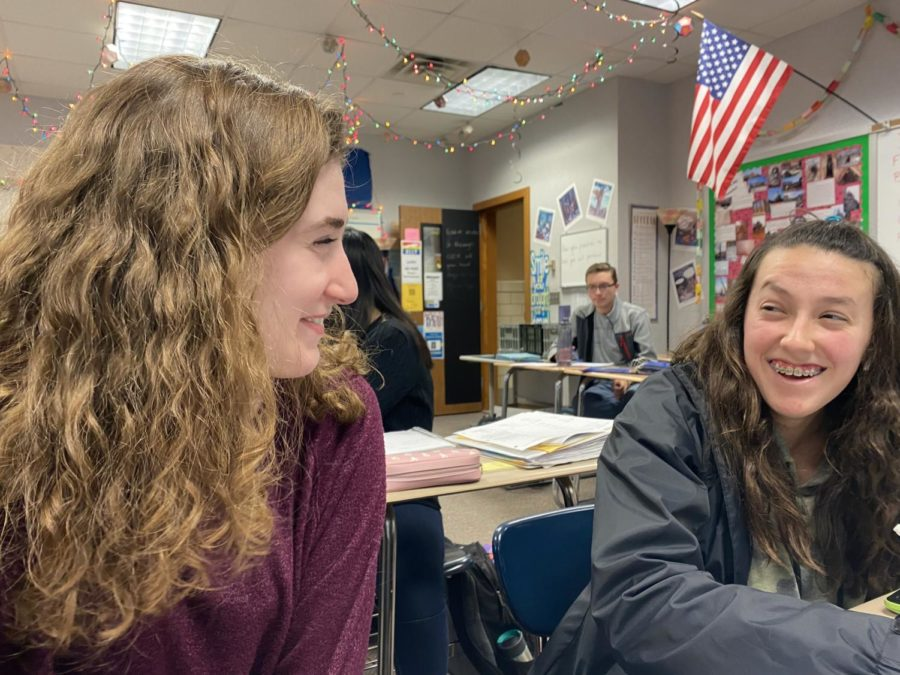 Sarah Konrad, new TEDx president and junior, talks to a friend during math class in the class period before a TEDx meeting. Konrad said she is excited for her new position in the club.
