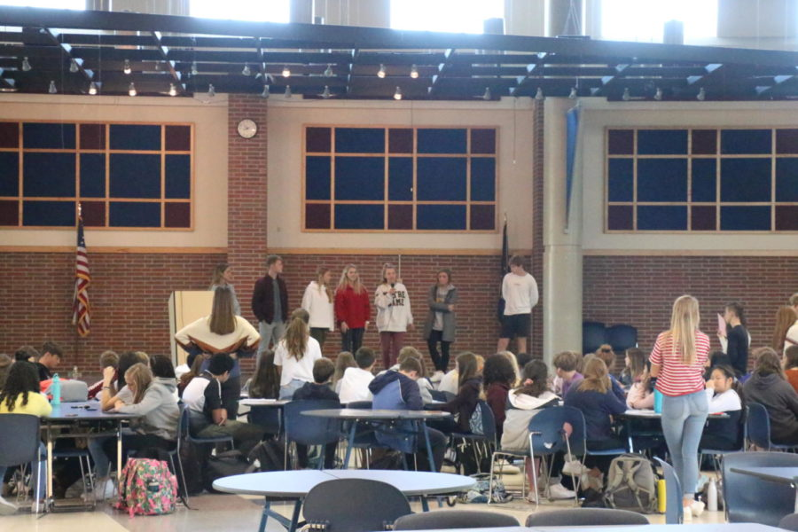 A House committee explains their plans for an event during a House meeting in the freshmen cafeteria on Oct. 15