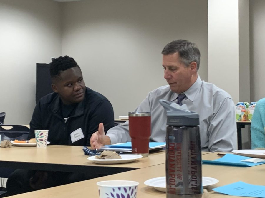Principal Tom Harmas discusses winter construction with speaker of the House Deion Ziwawo during a Superintendent's/Principal's Advisory Council meeting. Harmas said QR codes will be put up in ever SRT classroom next year so students can pull up directions to relocated offices.