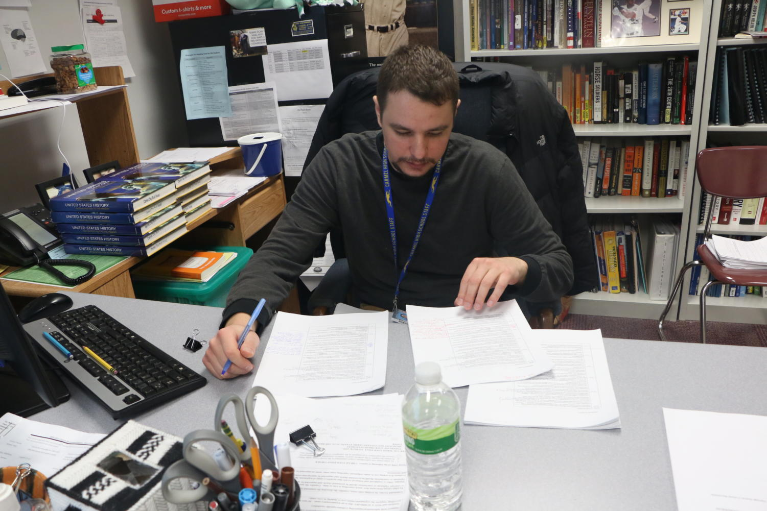 Club sponsor James Ziegler looks over assignments after class. According to Ziegler, the club only has one more meeting left before the end of the year.