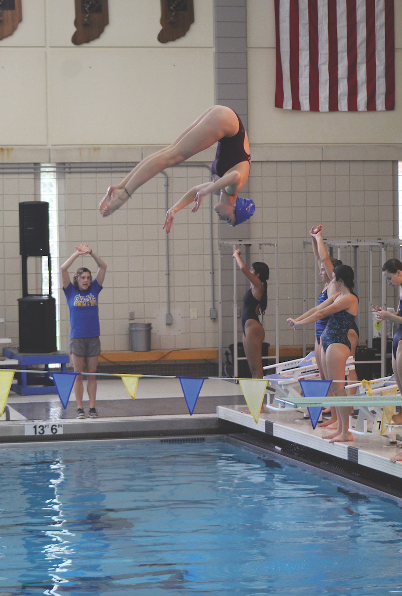 Diver and sophomore Darci Commons flips through the air during practice. Darci said that there are multiple types of dives including back, reverse, and inwards.