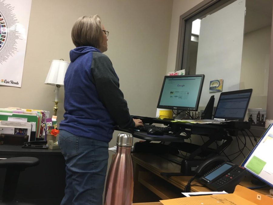 Terri Ramos, department chairperson for media and communications, checks the date of events on her computer. According to Ramos, the media center will host a staff pied day on Nov. 26.