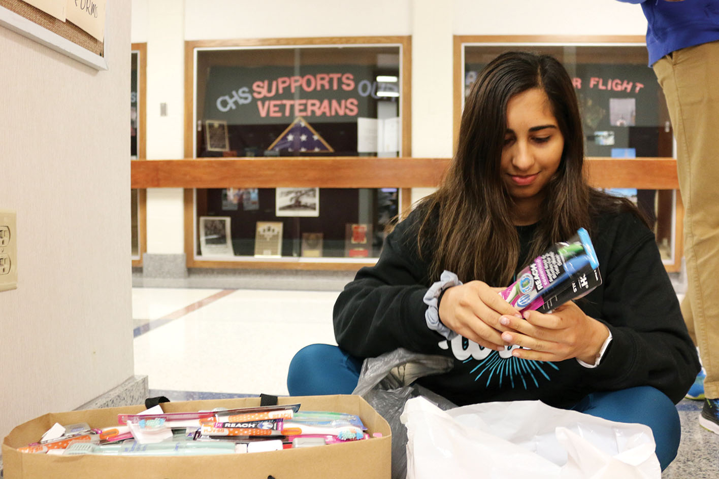 THE CLUB THAT SMILES BACK: Emily Deldar, founder and president of World Smiles Mission and senior, organizes toothbrushes for World Smiles Club during SRT. Key Club collected unused dental supplies to give to Deldar for World Smiles Mission.