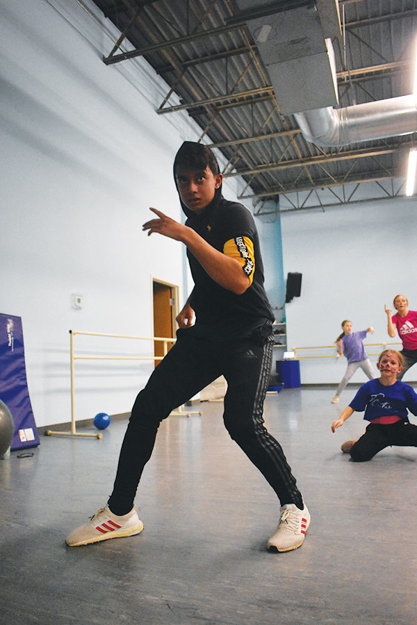 """Dancer and sophomore Damian Prabu practices his hip hop group dance at Expressenz. Prabu said he has been dancing for eight years and said his favorite is """"street."""""""