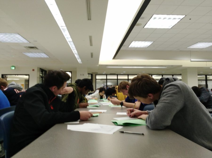 Students in DECA take the district exam during SRT in the Main Cafeteria on Dec. 2. The next round of district exams will take place on Dec. 6 in the Main Cafeteria during SRT.