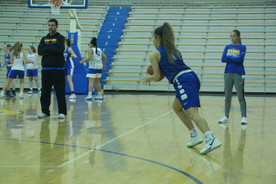 Kiara Gill, women's varsity basketball player and senior, and her teammates practice for their upcoming games. Gill said they will be practicing more zone offense, executions and plays.
