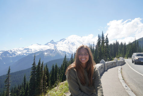 GREAT VIEWS:  Junior Michelle Boulos smiles next to a mountain range. Boulos said she loves traveling because she gets to experience it with family. Submitted Photo by Michelle Boulos