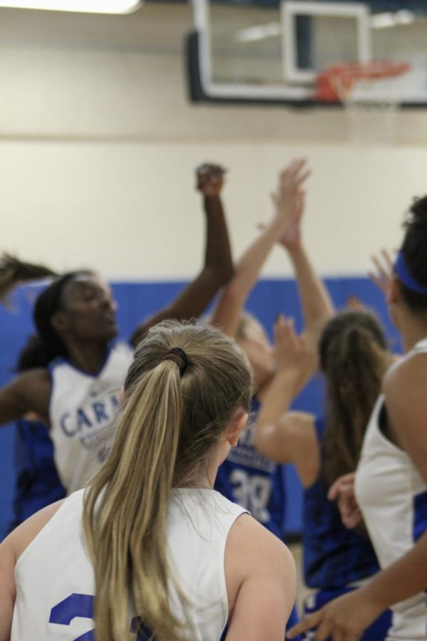 Members+of+the+women%27s+basketball+team+jump+for+a+rebound+during+a+drill+at+practice+on+October+25.+They+played+their+first+game+of+the+season+at+Homestead+on+November+9.%0A