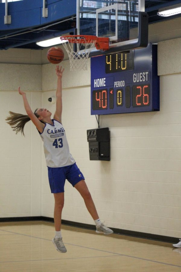 Sophomore Lizzie Nichols shoots a layup during practice on October 25.