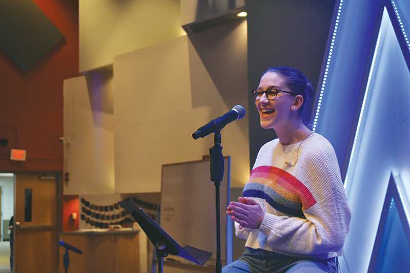 MOVING FAITH: Christina Carmichael, Christian volunteer worship leader, Allegro member and sophomore  sings during a worship rehearsal. Carmichael said she enjoys singing during worship because it has allowed her to express her faith confidently.